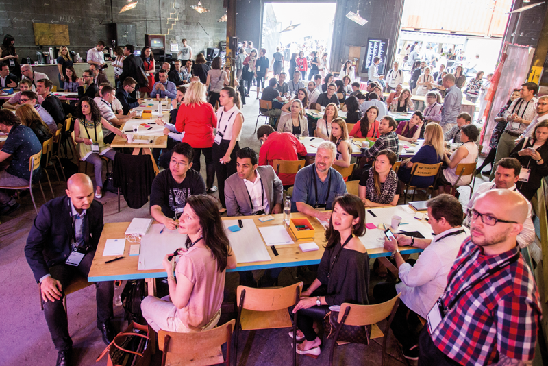 Conference goers are engaged in brain dates at C2 Montreal 2015