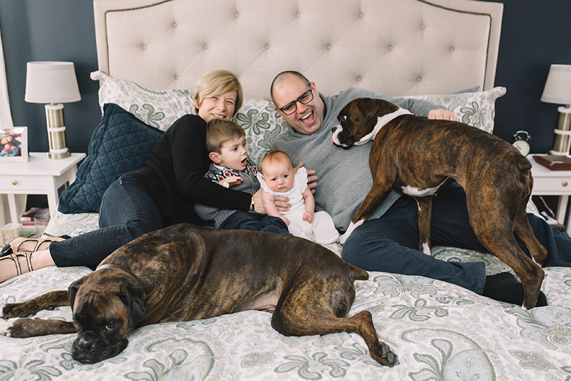 The Lagasse family with their two boxers, Rocky and Rosie.