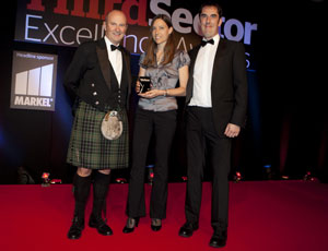 WWF's Shelley Haliburton and Dylan Parkes with Awards host Fred Macaulay