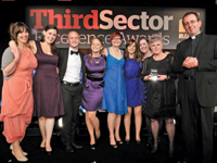 Sarah Dwyer, director of digital media at Beatbullying, holds the award alongside colleagues [l-r] Georgia Dale, Steveie Voogt, Stephen Hill, Sara Maden, Francesca Cross, Jeanette Clement, Jennifer O'Brien and host Reverend Richard Coles