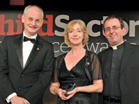 Mark Lafferty, deputy HR director at Save the Children, and Joan Coyle, its HR director, collect the award from host Rev Richard Coles
