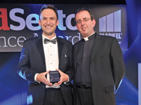 Reverend Richard Coles [r] presents the award to Matthew Bardby, marketing and communciations manager at The Queen's Nursing Institute