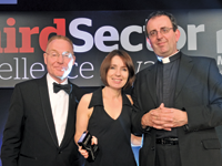 Marian Keen-Downs, head of targeted programmes at Booktrust, collects the award from Richard Evans [l], chief executive of CfA, and host Rev Richard Coles