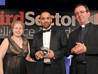 Irfan Akram, fundraising manager at Muslim Hands, accepts the award from Donna Young, general manager of BT MyDonate, with host Reverend Richard Coles