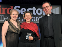Elephant Family trustee Lorin Gresser receives the award from BT MyDonate general manager Donna Young and host Reverend Richard Coles