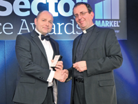 Andrew Hufford, commercial director, St Peter's Hospice [l] with host Reverend Richard Coles