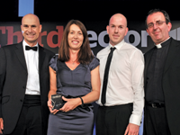 Tracey Horner, head of lenwithcare.org takes the award with [l] John Hatfield, operations director, and Jon Lucas digital project manager at the agency Bluefrog, with host Reverend Richards Coles
