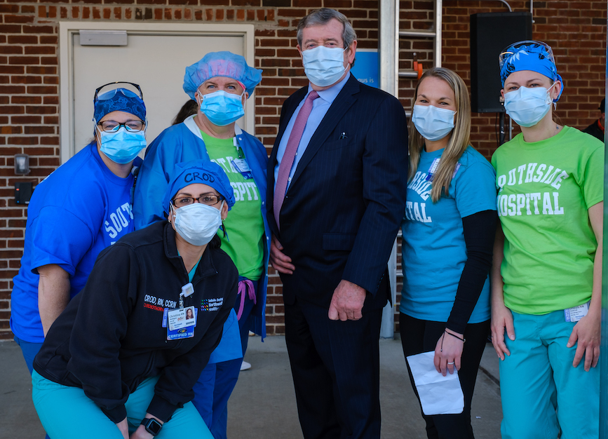 Michael Dowling standing masked with Southside nurses, photo credit: Northwell Health
