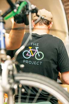 man from behind wearing bike project t-shirt