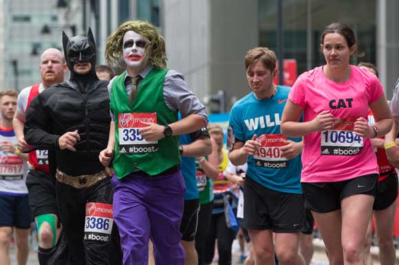 runners dressed as batman and the joker