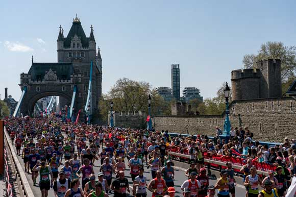 runners crossing tower bridge
