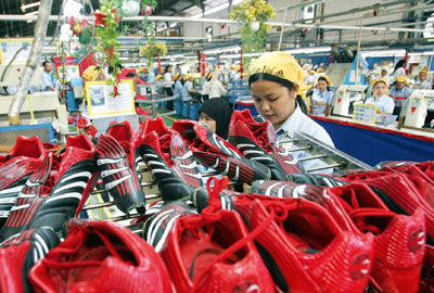 Workers at an Adidas shoe factory in West Java, Indonesia