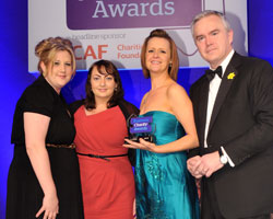 The Co-operative Foundation receive their award from Huw Edwards