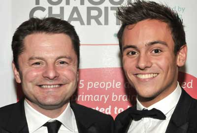 Chris Hollins [r] with Tom Daley
