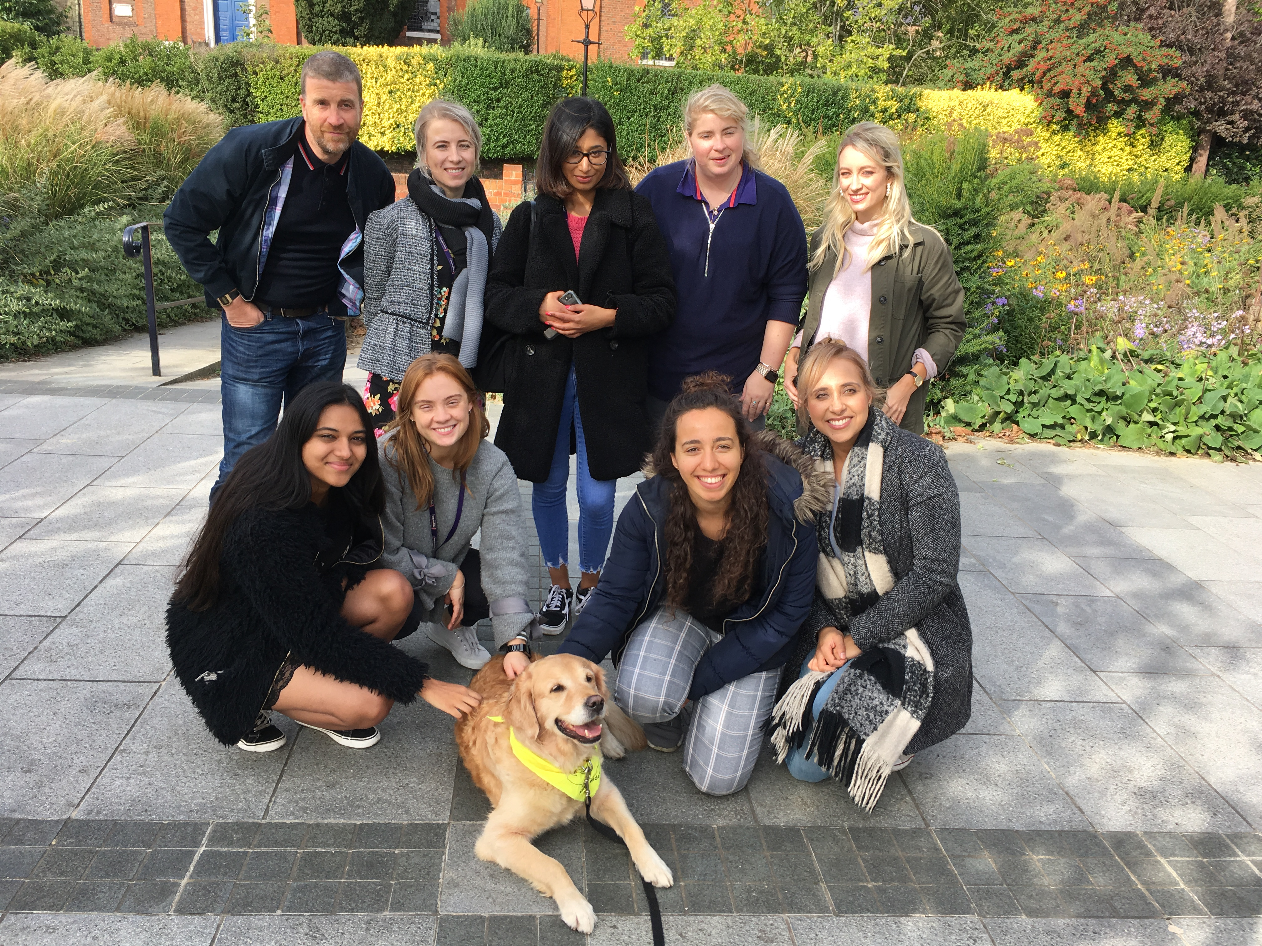 Haymarket employees with Juno the dog from Therapy Dogs Nationwide