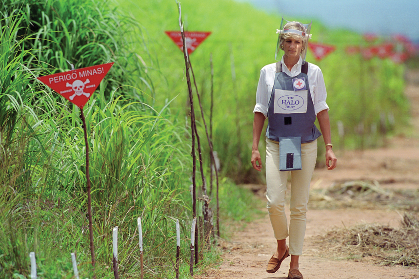 Diana walking through a minefield in Angola