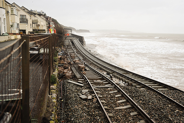 Railway track is exposed and left hanging after the sea wall collapsed in Dawlish in 2014. Pic credit: Ben Birchall / PA Archive/PA Images