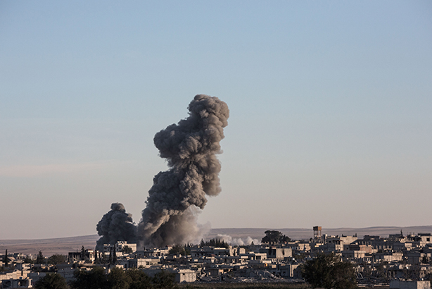 Smoke rises from an Islamic State position in the town of Kobane. Pic credit: Konstantinos Tsakalidis / Demoti / Demotix/Press Association Images