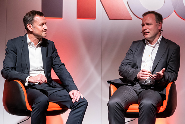 Danny Rogers (L) speaks to Sir Craig Oliver (L) on stage at PR360