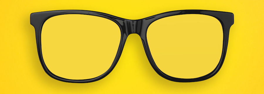 glasses against a yellow background