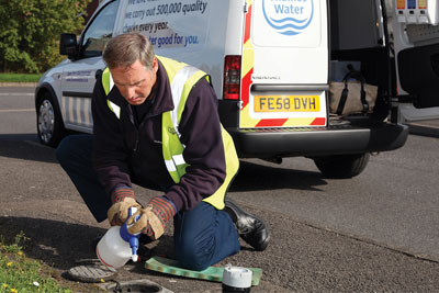 Thames Water employee checking a water meter