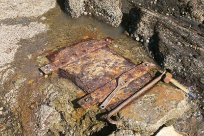 Investigators found sewage leaking from a corroded inspection hatch and flowing down the beach (credit: Environment Agency)