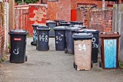 Wheelie bins in a backstreet. Credit: Ian Sidlow/Dreamstime.com