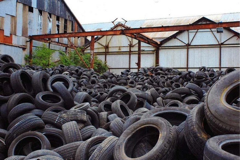 Thousands of waste tyres illegally dumped in a large yard (photograph: Natural Resources Wales)