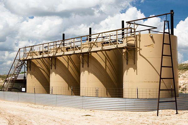 Storage tanks on an oil and gas production site. Photograph: Jim Parkin/123RF