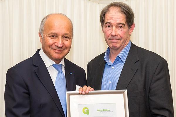 Jonathon Porritt presents COP21 president Laurent Fabius with the Green Ribbon award for 'best environmental achievement internationally'