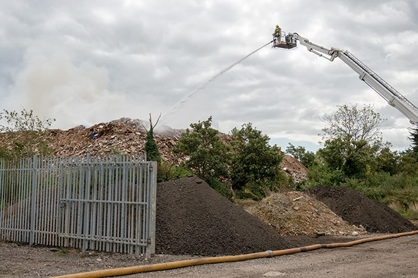 The local Fire Service used nearby ponds and a crane to fight the 2-month blaze. Photograph: Essex County Fire & Rescue Service