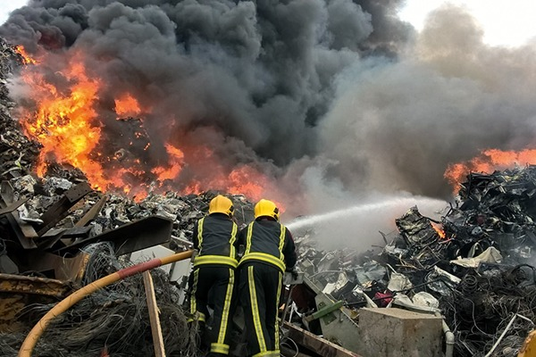 As well as being a safety risk, waste fires damage the environment through toxic smoke plumes, firewater run-off and hazardous residues. Photograph: West Midlands Fire Service