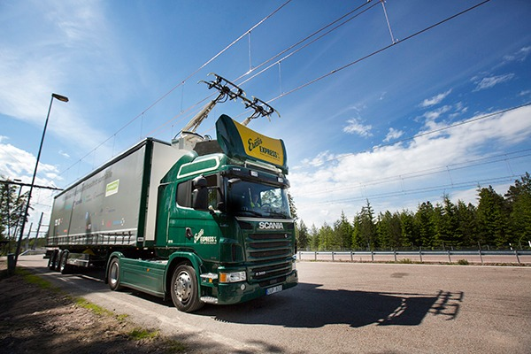 "Promising technology or ""slightly bonkers""? Siemens and Scania's hybrid lorry uses power from electric cables strung over a 2km stretch of Swedish motorway. Photograph: Scania"