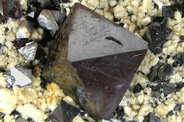 Magnetite is a naturally-occurring mineral but can also be created by mechanical wear or combustion processes. Photograph: Rob Lavinsky, iRocks.com CC-BY-SA-3.0