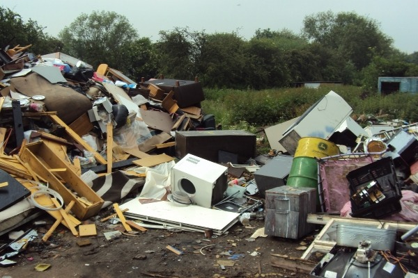 Murphy had used the land to store and burn large quantities of mixed waste including metal, wood, electrical items and construction and demolition waste. Photograph: Environment Agency