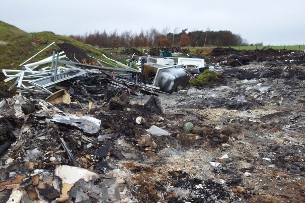 Pickering burnt waste including uPVC doors, window frames, wood and wheelie bins. Photograph: Environment Agency