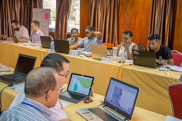 People using Renewable Energy Space Analytics Tool on laptops. Photograph: Institute for Environmental Analytics