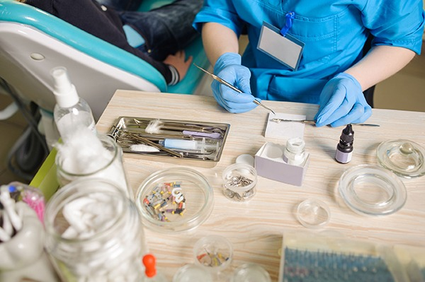 Dentist with gloves mixing filling material. Photograph: anatoliygleb/123RF