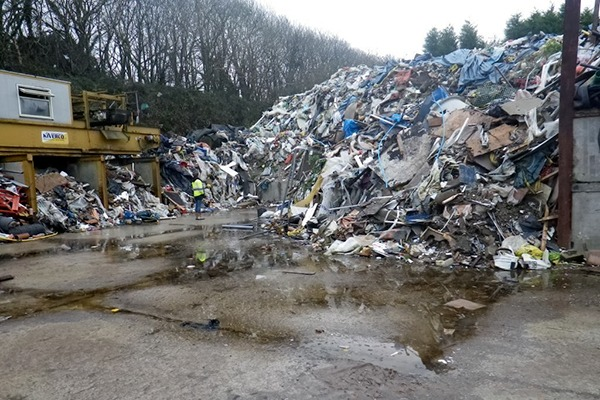 Pile of illegally stored waste in yard. Photograph: Environment Agency