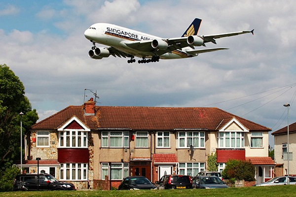 Plane flying over houses on descent into Heathrow.