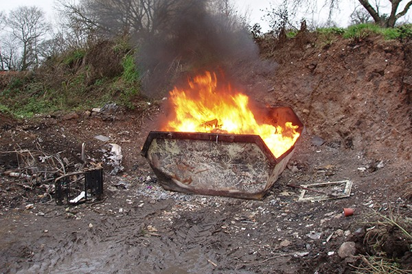 Fire in waste skip. Photograph: Environment Agency