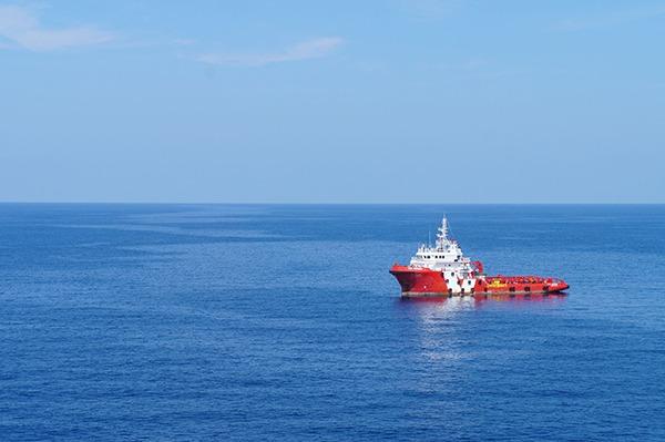 Supply boat out at sea. Photograph: suwatpo/123RF