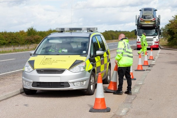 DVSA officers inspect a lorry
