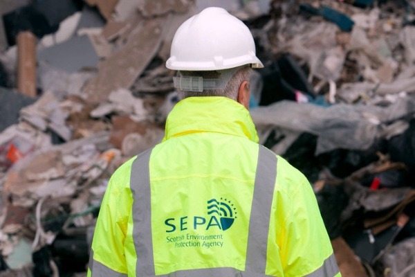 A SEPA inspector at a licensed site.