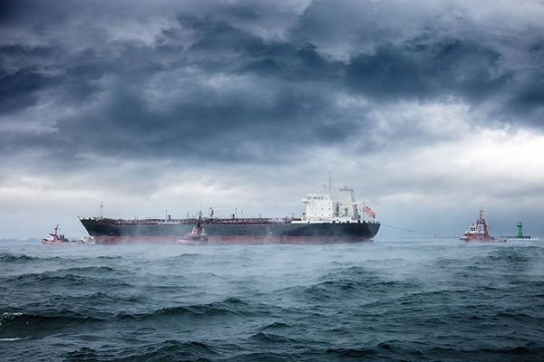 Transport vessel and tug boats. Photograph: Nightman1965/123RF