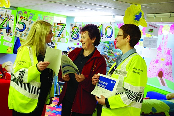 Female Environment Agency officers talking to school teacher. Photograph: Environment Agency