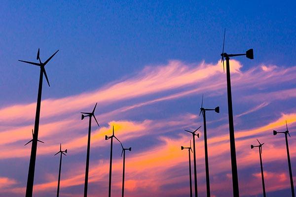 Wind turbines at sunset. Photograph: Apichart Tangcharoenbamroongsook/123RF