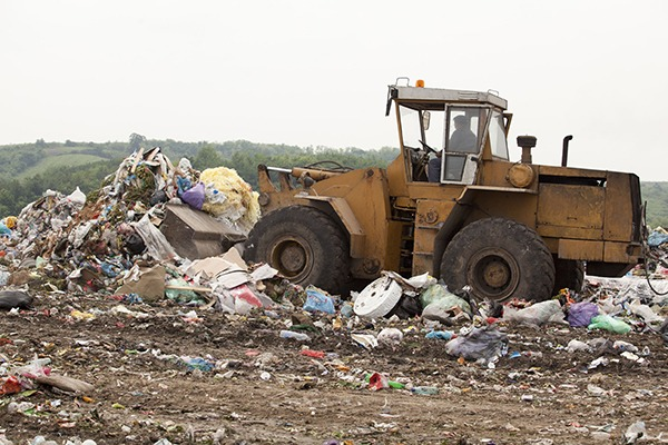 Tractor on landfill