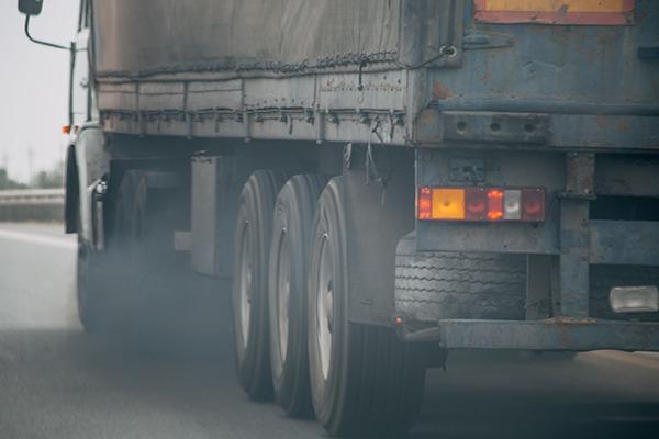 Truck emitting smoke. Photograph: dedmityay/123RF