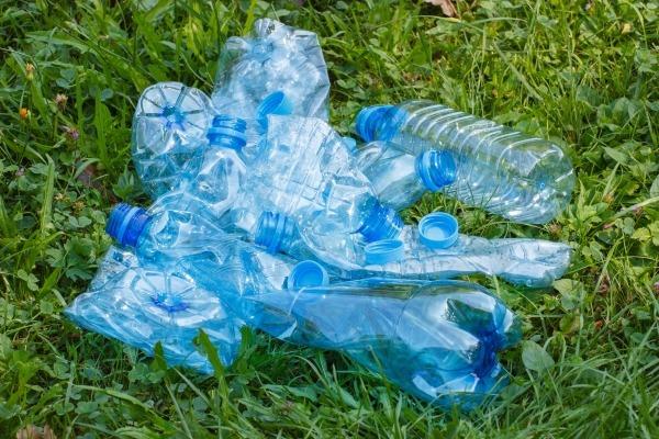 Pile of plastic bottles on grass. Photograph: Ratmaner/123RF